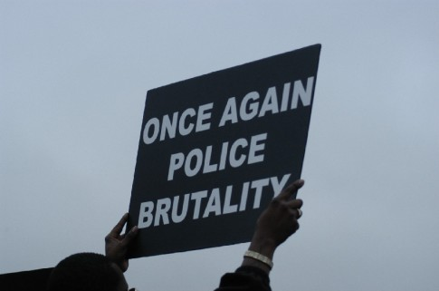 #FergusonOctober protesters demanded an end to police misconduct. (Image via PoliticusUSA)