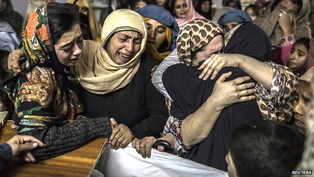 Mothers grieving loss of children. Photo via BBC, courtesy Reuters