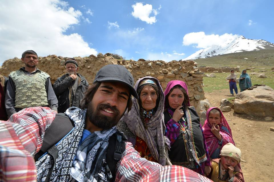 Ansari poses for a selfie with Wakhi locals in Chikar, Pakistan. Photo courtesy Facebook (Mobeen Ansari)